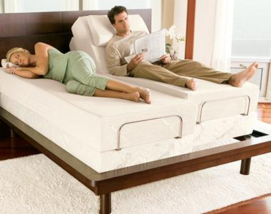 A couple laying on a comfy foam bed